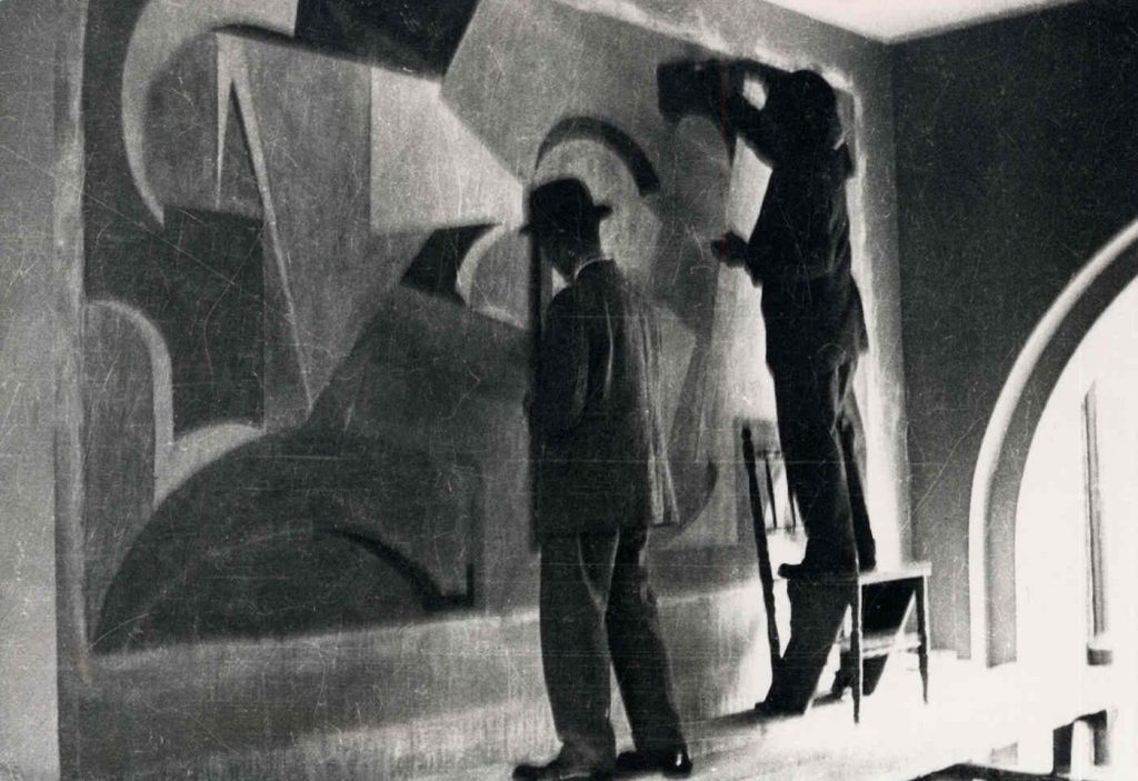 Hans Arp and Otto van Rees at work on the mural for the Pestalozzi School, Zurich 1915