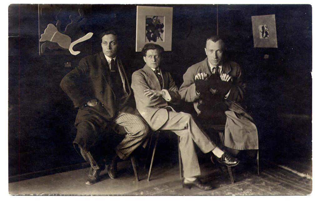 Marcel Janco, the art dealer Miecislas Sterling and Hans Arp at the Galerie Wolfsberg, Zurich, 1918