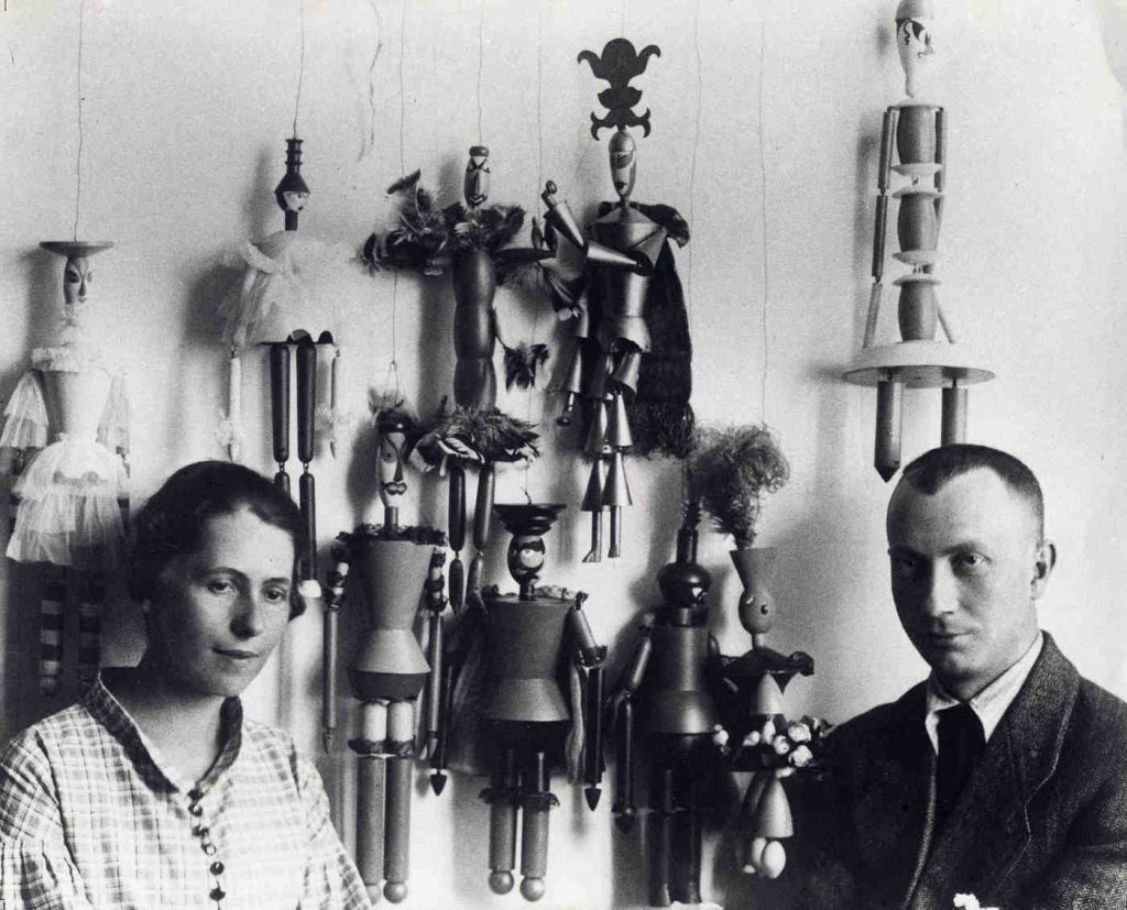 "Sophie Taeuber and Hans Arp with the marionettes she designed for the opera ""König Hirsch,"" Zurich 1918 (photograph: Ernst Linck)"